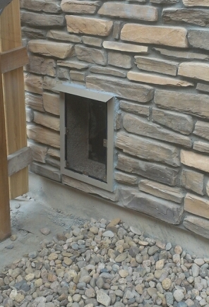 Stone wall with a Hale Pet Door installed