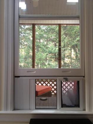 A Hale Pet Door Vertical Omni Window Dog Door Installed